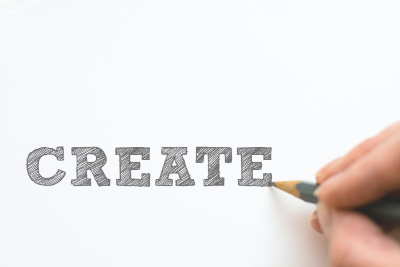 the word create written in pencil